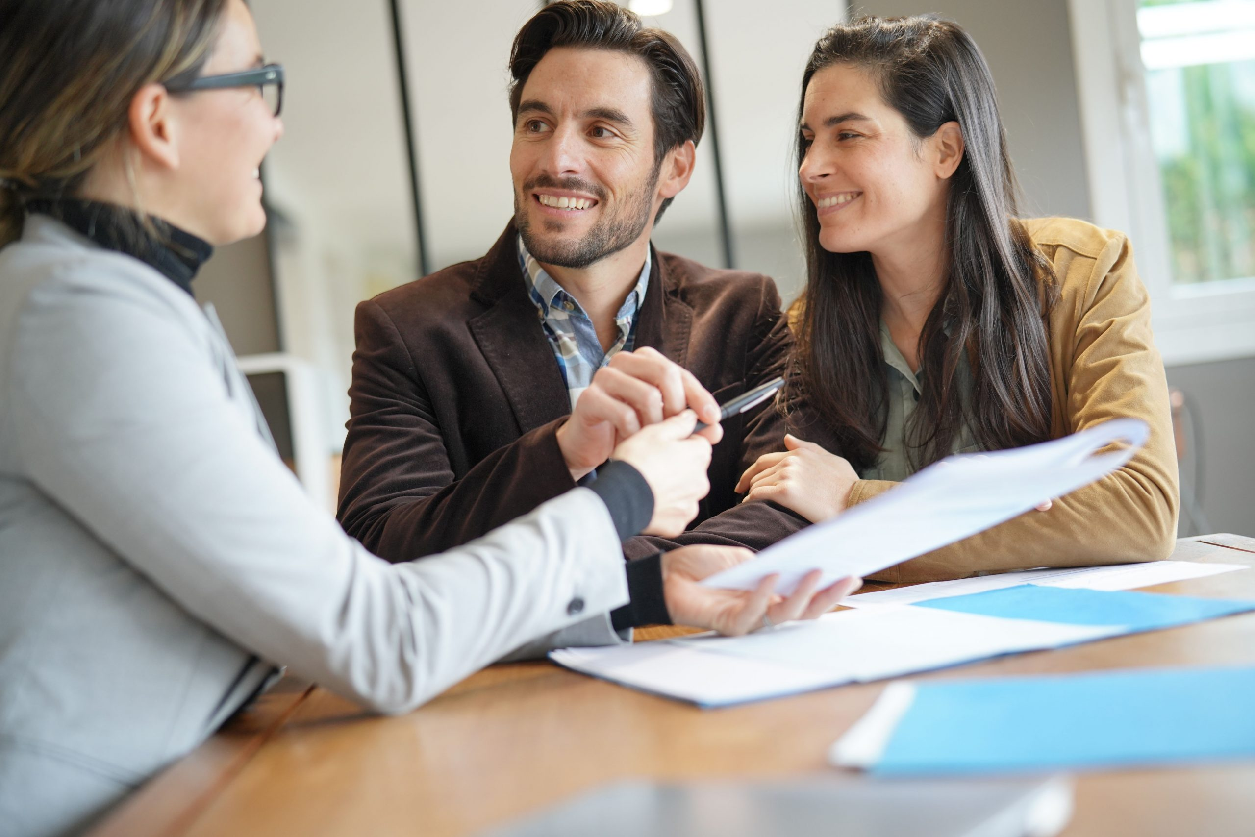 Attractive Couple Signing Sales Agreement With Real Estate Agent