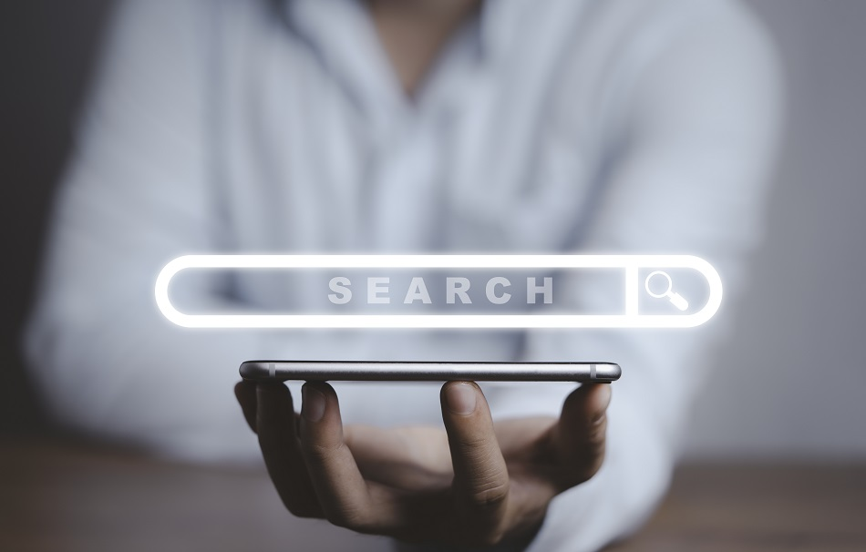 Businessman Holding Smartphone With Virtual Search Engine Browse