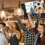 Group Friends Watching Sport Together Celebrating Victory Bar